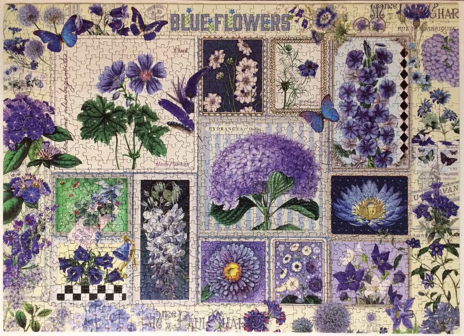Brand: Cobble Hill Puzzle Company  Title: Blue Flowers jigsaw puzzle  By: Barbara Behr  Pieces: 1000  Size: 26.625