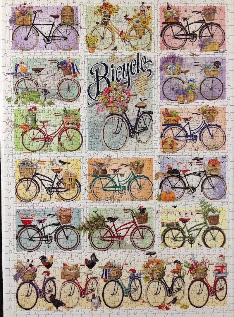 Bicycles-Puzzle. After I managed to work the border I started with the 3 purple bikes, then the pink-coral bikes, onto the greens and leaving the yellows for last - besides the 'main' bicycle word.