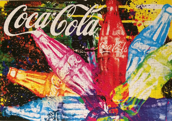 Brand: Buffalo Games  Title: Splash of Coca Cola  Pieces: 300 medium to large size pieces  Size: 21.25