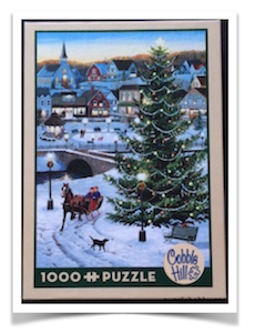 Brand: Cobble Hill Puzzle Company  Title: Village Tree  Artist: Persis Clayton Weirs  Pieces: 1000  Size: 19.25″ x 26.625″ / 48.9 x 67.6cm  Shapes: Random cut, odd-small-large pieces