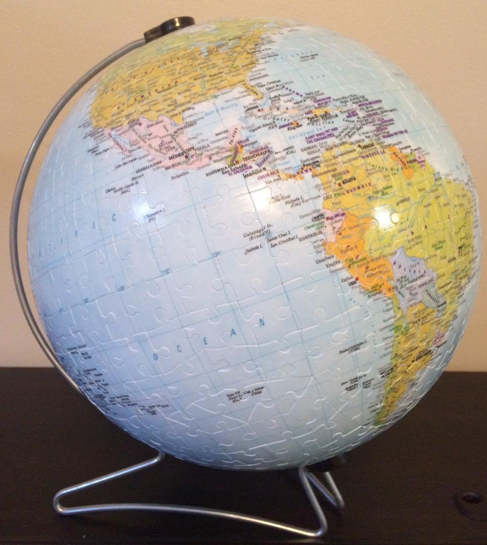 """Brand: Ravensburger, Title: Earth 3D Puzzle, Pieces: 540 plastic pieces, Size: 8.7""""/22cm."""