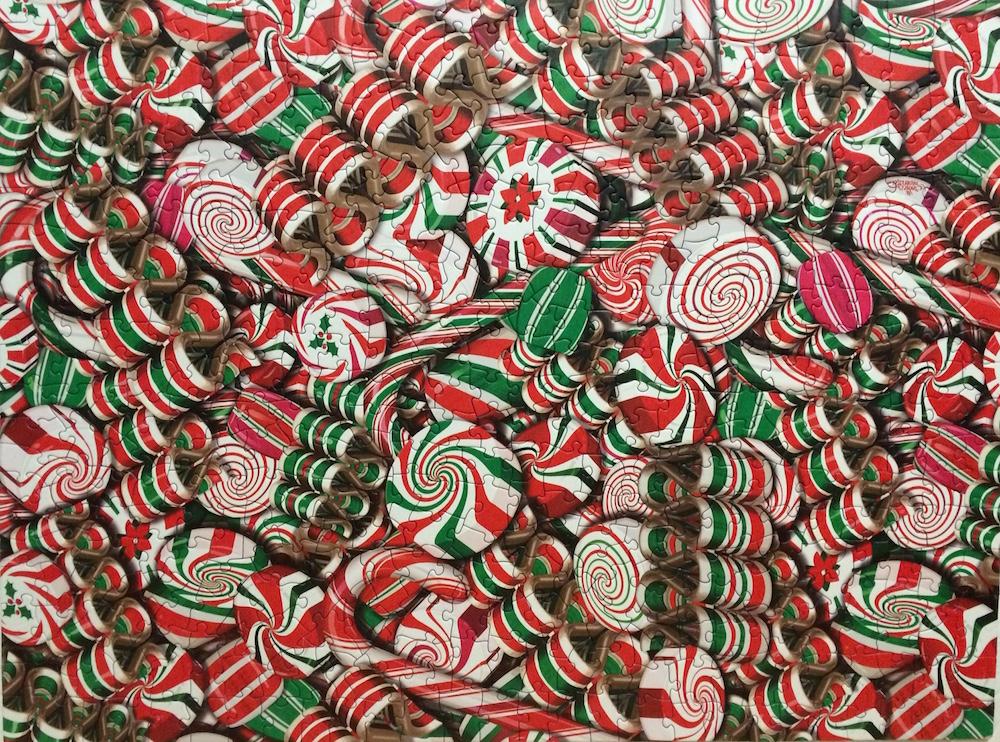 Brand: Cobble Hill Puzzle Company  Title: Holiday Candy Jigsaw Puzzle  By: Cobble Hill Puzzle Company  Artist: Andrea Mistretta  Pieces: 500  Size: 24